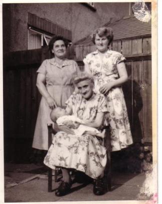"4 generations of the Moss family, taken in1955 a. right Ron's wife Sylvia Moss b. left Ron's mother Sarah Moss c. Eliza ""Granny"" Parkes - Ron's maternal grandmother - seated d. holding Ron's daughter Cheryl Aston (nee moss)"