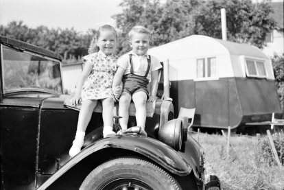 Ron's daughter Cheryl and maternal nephew Stephen Griffiths both aged 4 taken at Holt Fleet sitting on Ron's Austin with Ron and Sylvia's caravan in the background – 1959.