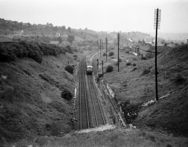 Diesel Multiple Unit DMU approaching Old Hill tunnel which runs from Old Hill to Rowley Regis 1959.