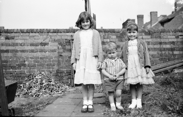Taken in 1960 in the back garden of Ron's home in Dudley Street, Old Hill (the street no longer exists demolished to make room for new road system and housing) a. Left Ron's maternal niece Gillian Derrick (nee Peniket) aged 8 b. Centre Ron's son Gary – aged 2 c. Right Ron's daughter Cheryl – aged 5.