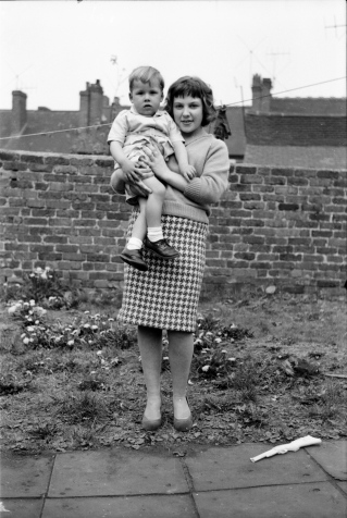 Ron's 2 year old son Gary being held by his babysitter - Valerie back garden Dudley Street , Old Hill.